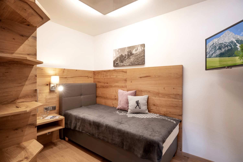 Appartement Suite Steiner Schlafzimmer mit Einzelbett