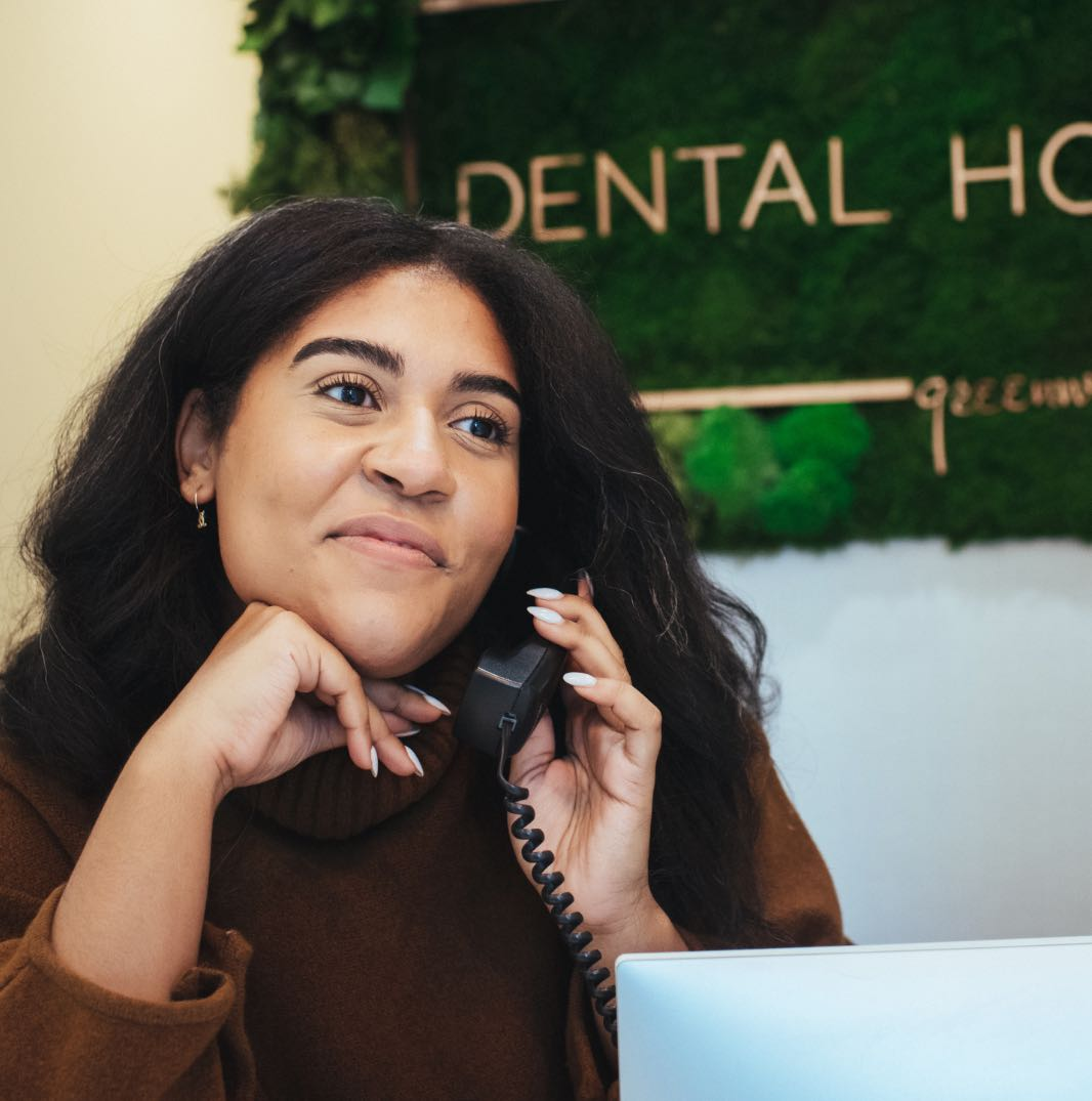 Photo of a Dental House team member on the phone
