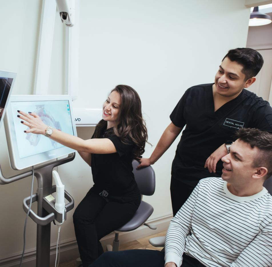 Photo of Dr. Krasilnikov showing a patient scans on a monitor