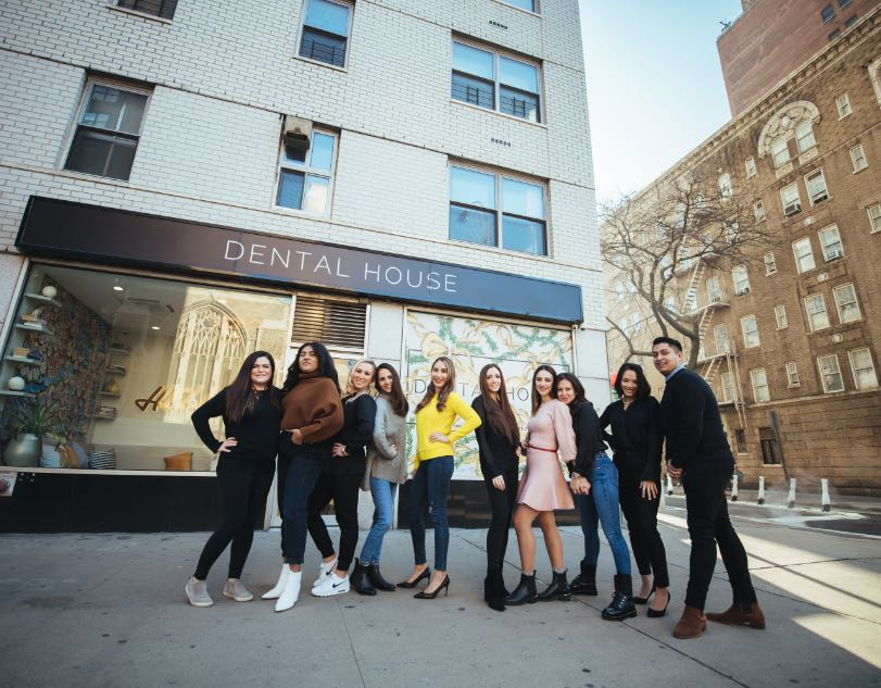 Photo of the Dental House team out in front of the office