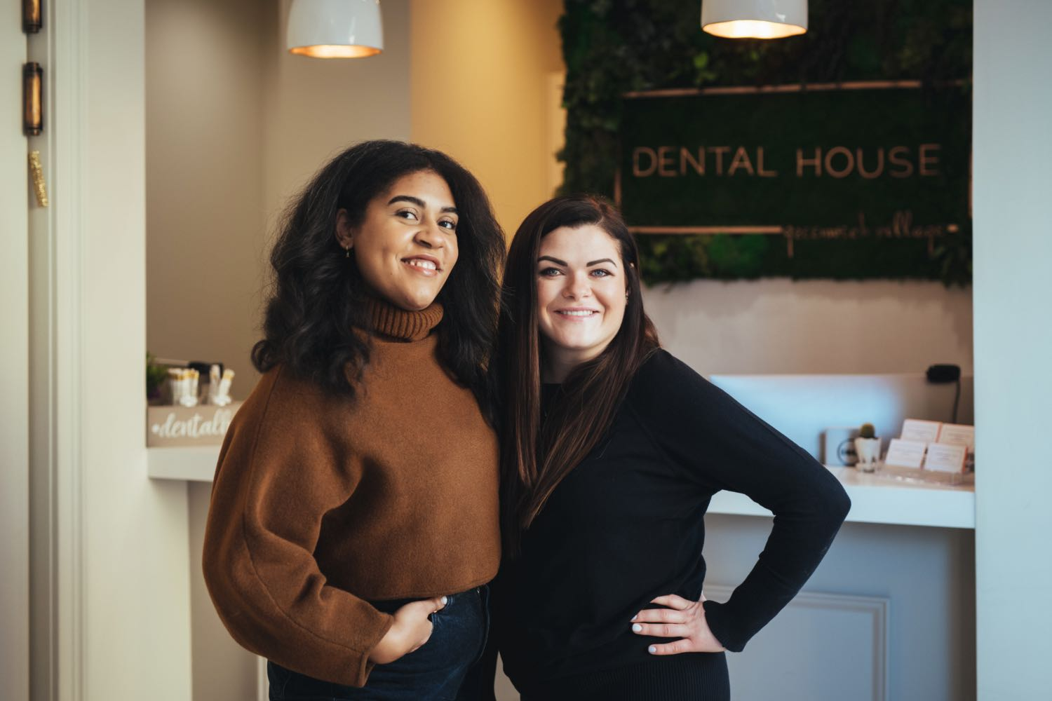 Photo of two Dental House team members posing together