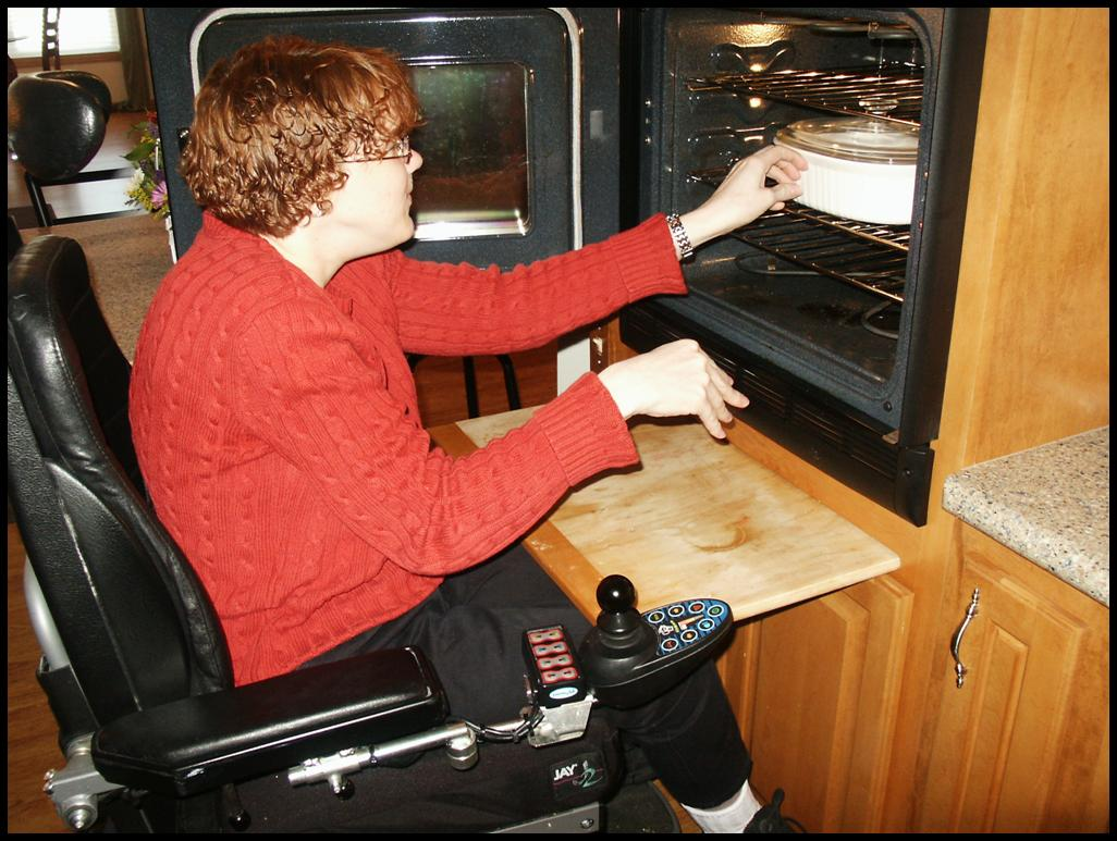 Accessibility Design client using modified oven space in wheelchair