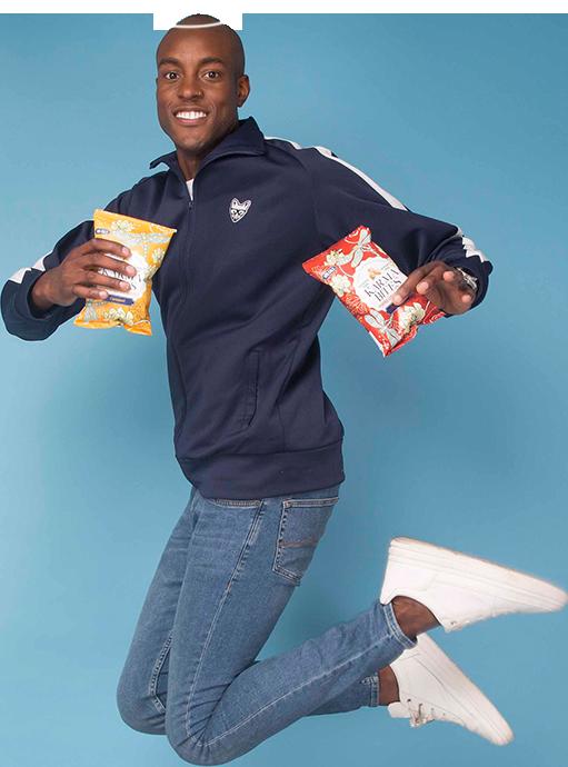 Model jumping and holding Karma Bites packs