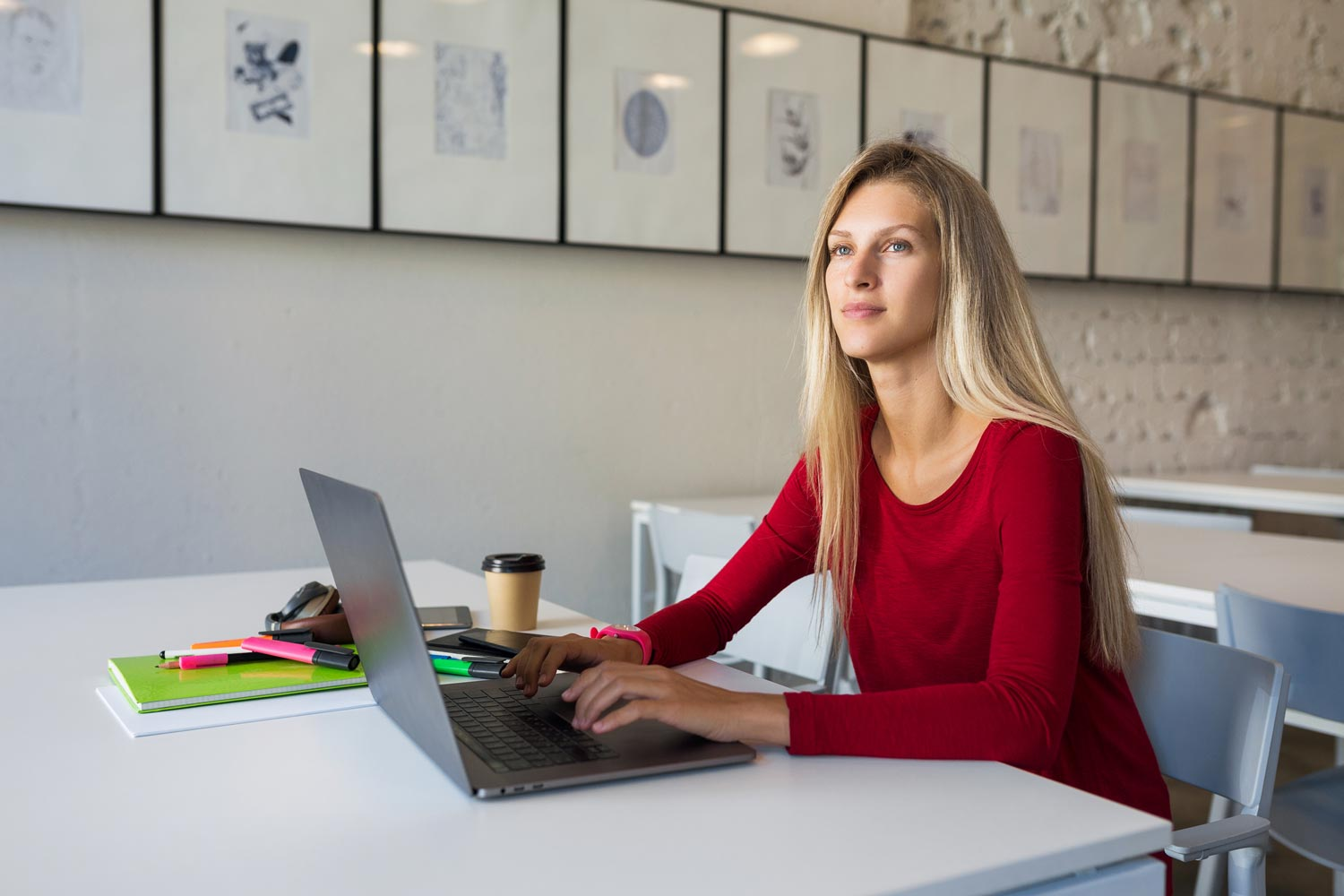 Female remote worker contemplating her job offers.