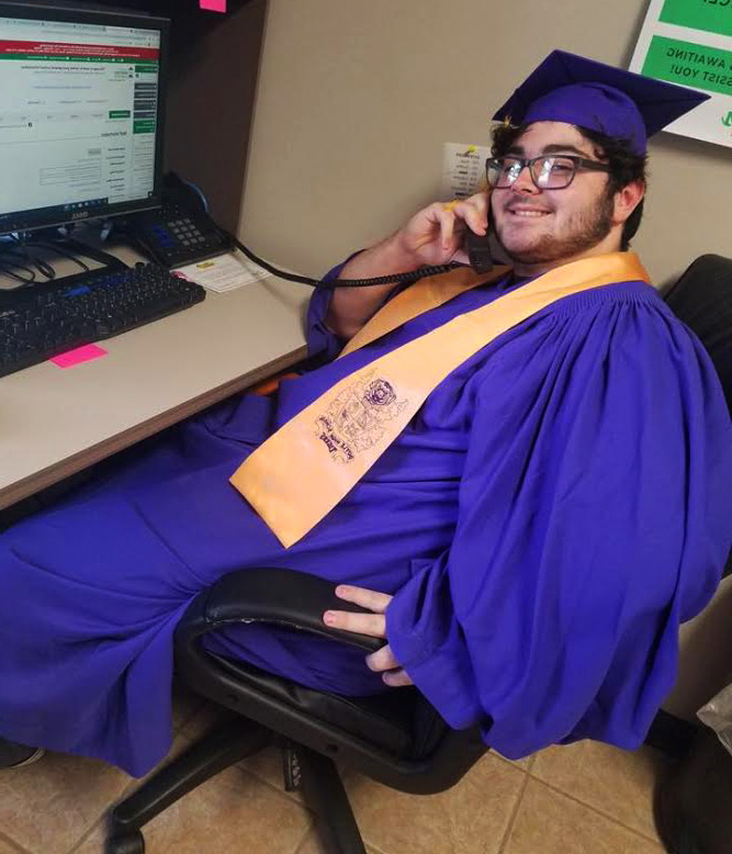 High-School Senior learning at a Geaux-Jobs center while doing clerical work.