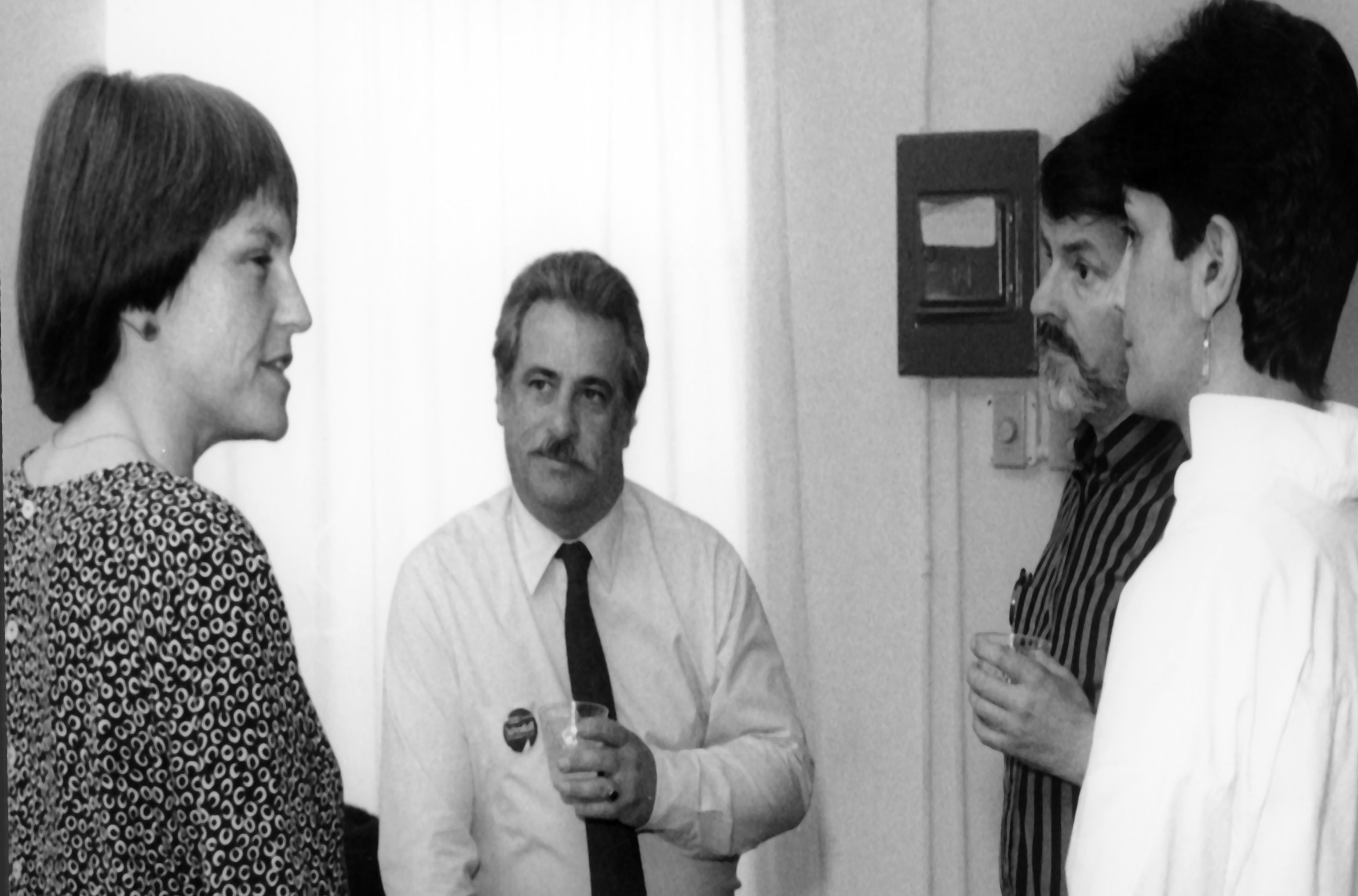 Roberta Achtenberg (left) talking to a small group of people at a fundraiser held at Park Street Community Center. San José State University Special Collections & Archives.