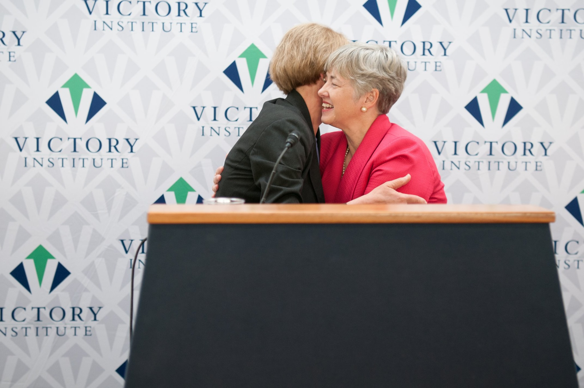Former Houston Mayor Annise Parker and U.S. Senator Tammy Baldwin embrace at Victory Institute's Pride Month reception on Capitol Hill on June 12, 2019.