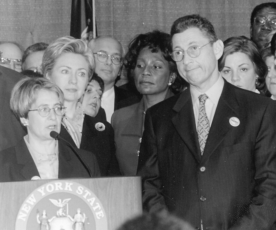 Flanked by U.S. Senator Hillary Clinton and New York Assembly Speaker Sheldon Silver, Assemblywoman Deborah Glick speaks at an April 2000 press conference urging the passage of a hate crimes bill.