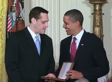 Stuart Milk accepts the Presidential Medal of Freedom on behalf of Harvey Milk from President Barack Obama.