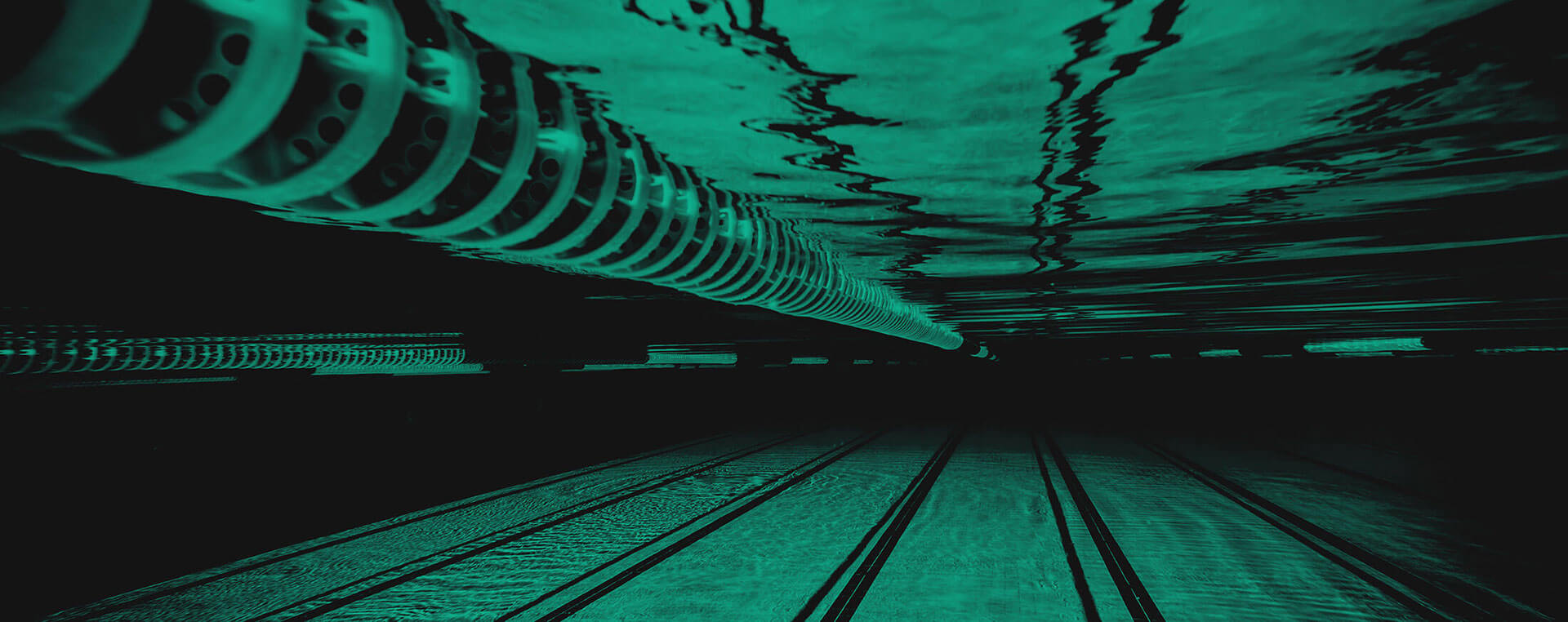 Green and black background image with a shot of the swimming pool underwater