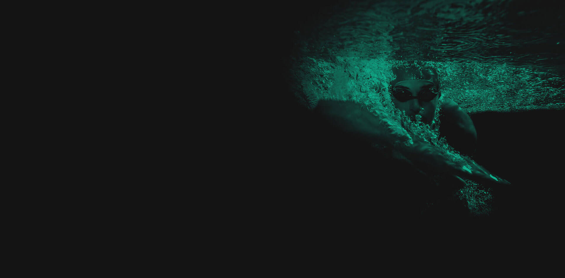 Green and black background image with a man swimming