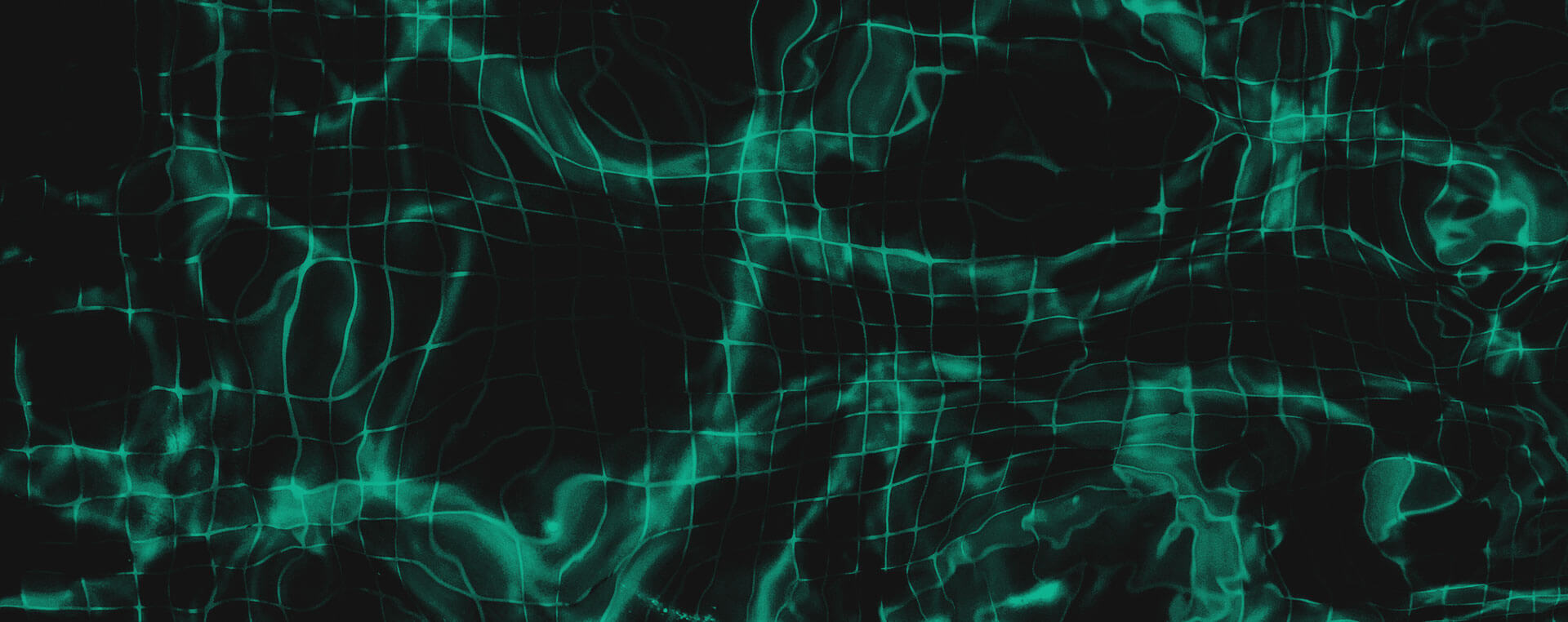 Green and black background image with a close up shot of a pool with water
