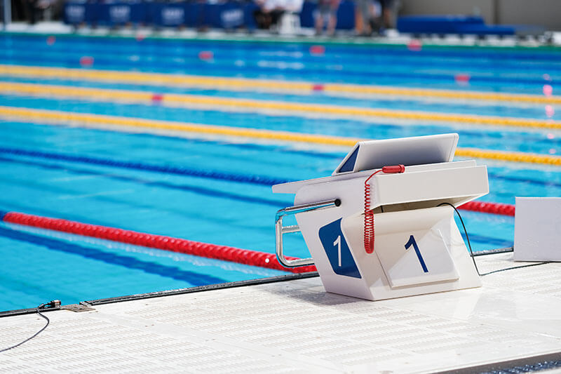 Swimming pool starting block with the number 1 printed on the front and side