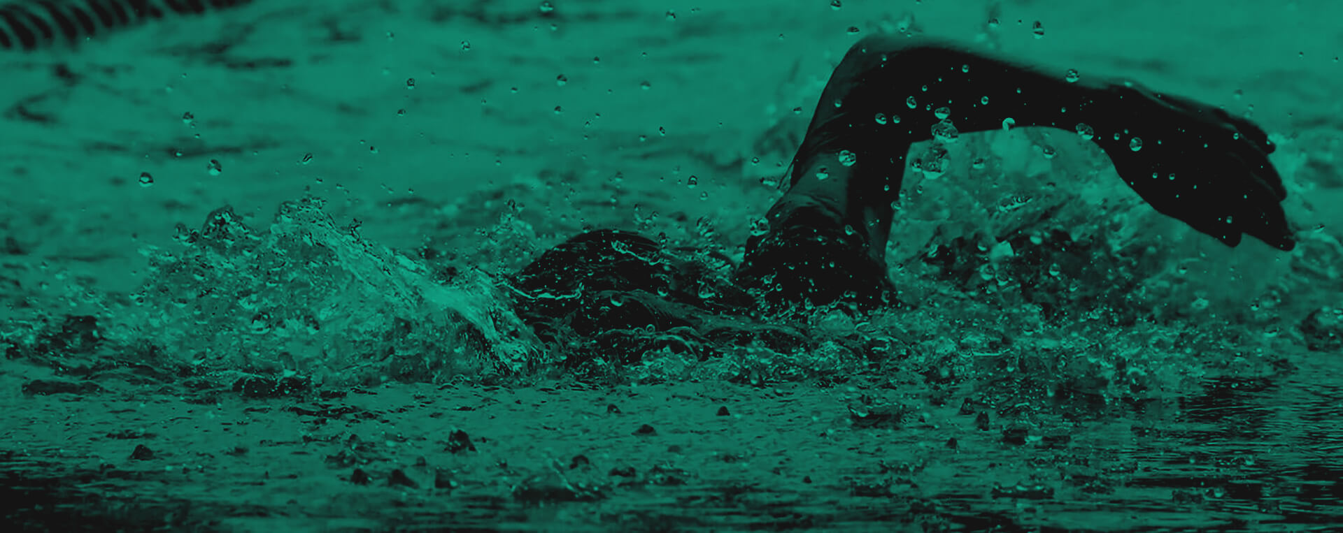 Green and black background image of a man swimming in a pool with his arm raised out of the water