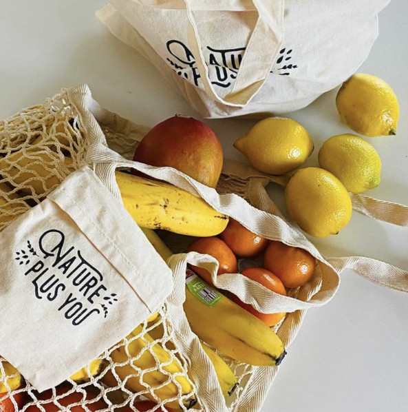 Grocery bag on the counter with produce spilling out