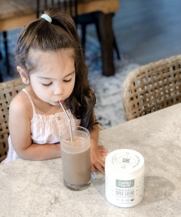 Young girl enjoying a Chocolate Super Greens smoothie