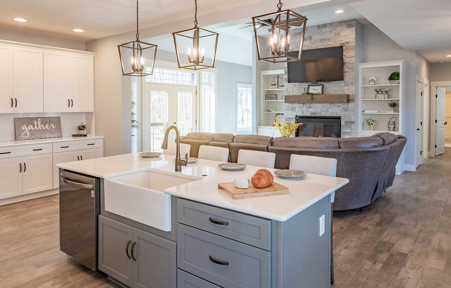 The Hearthstone is a 2,590 square foot, modern farmhouse style home with super sized covered front porch.