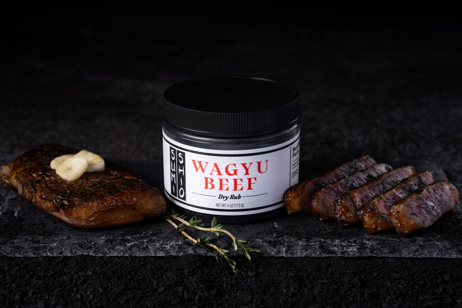 Sumi Shio Wagyu Beef Dry Rub with two A5 Wagyu Steaks on Granite Countertop