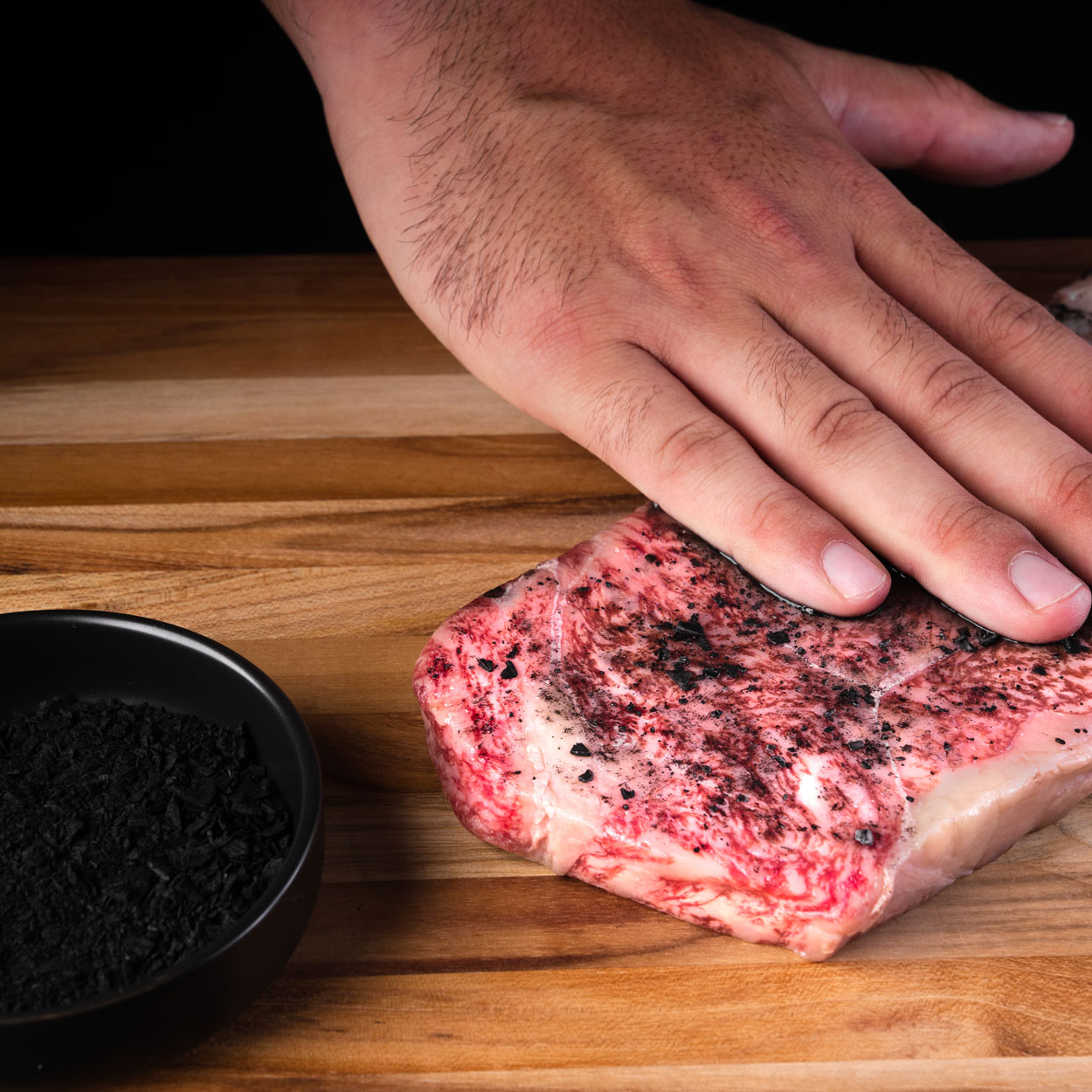 Raw Wagyu Beef being rubbed with Sumi Shio Dry Rub