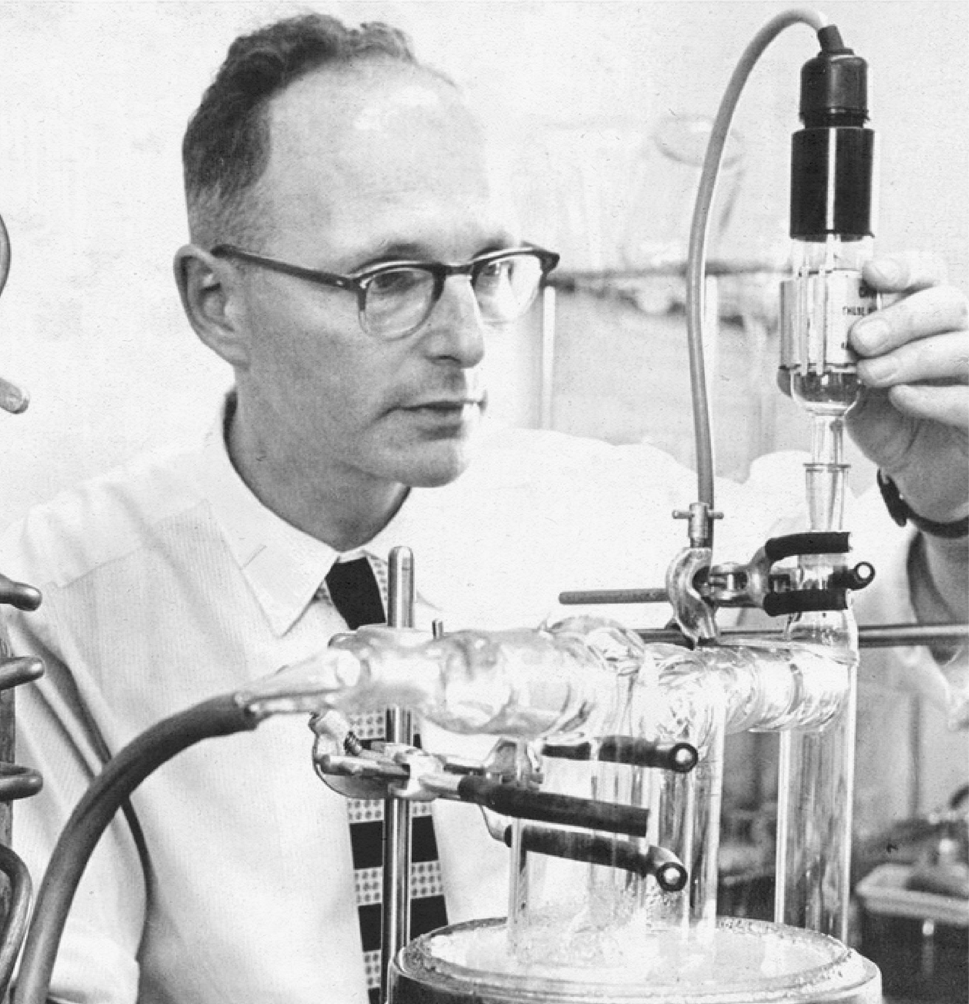 Vintage photo of a man studying scientific tubes.