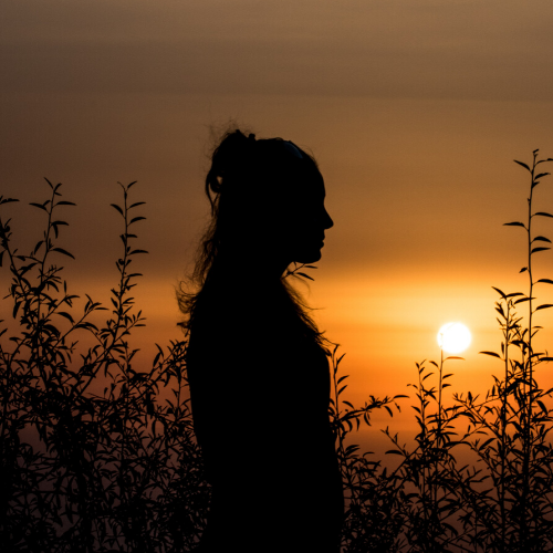 Woman in sunset.
