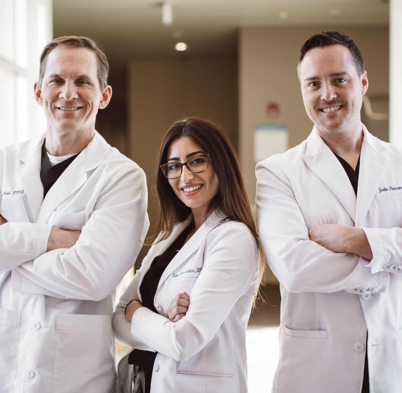Photo of Englewood dentists, Dr. Thomas Reed, Dr. Sahel Khorshidian, and Dr. Justin Pearson