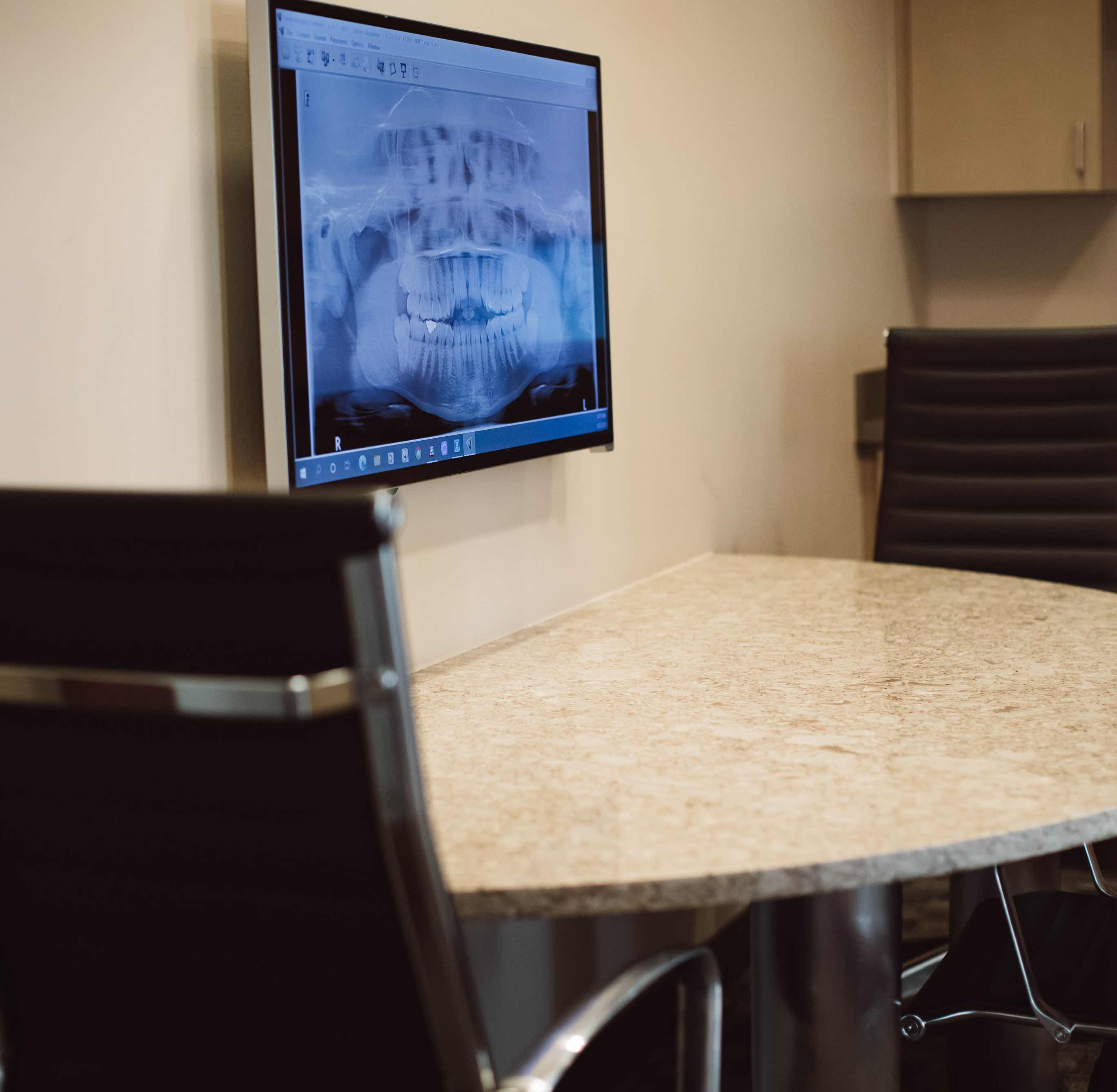 Photo of a small table and a dental x-ray image in our consult room