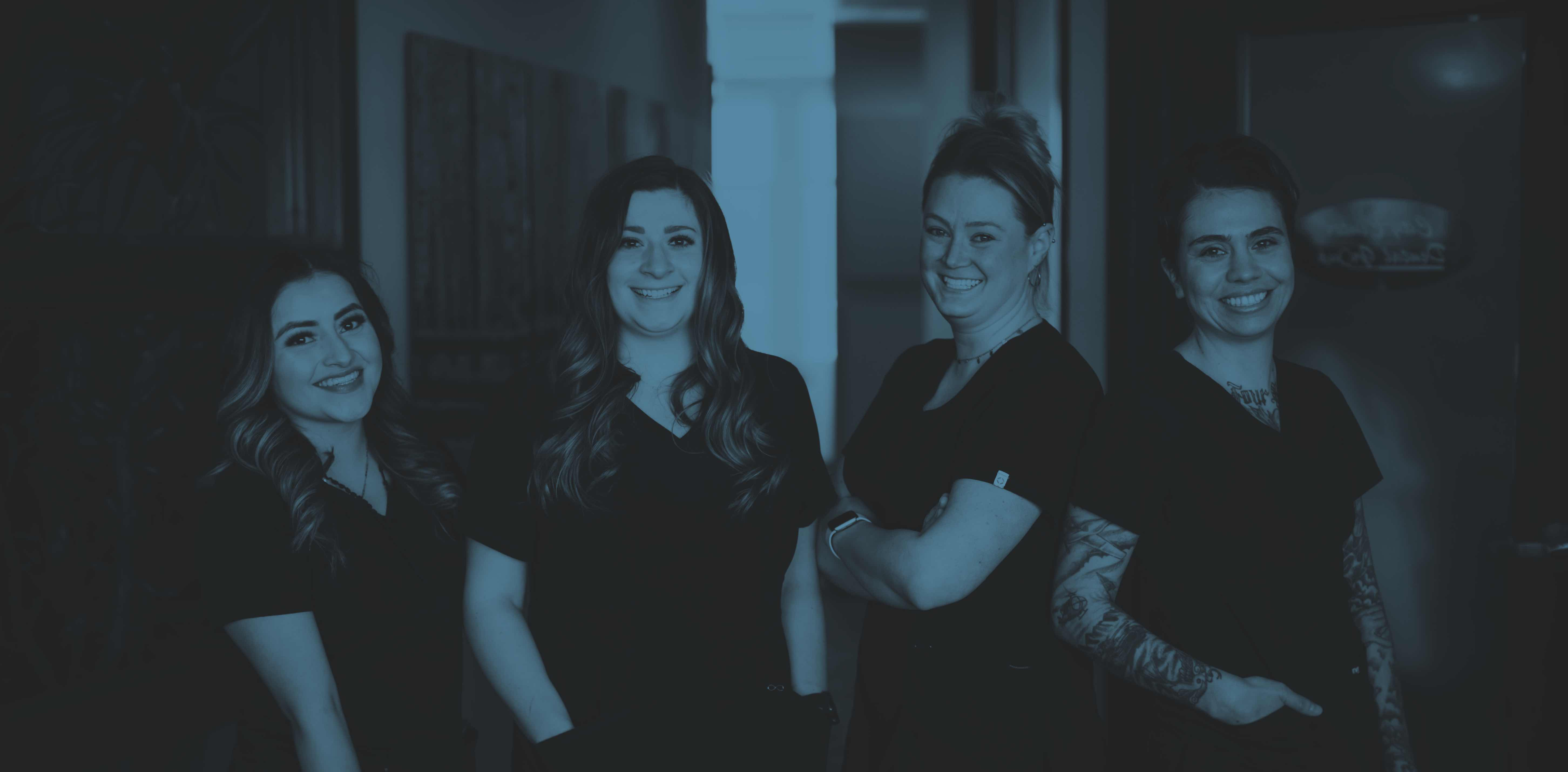 Photo of four City Center Dental Group team members