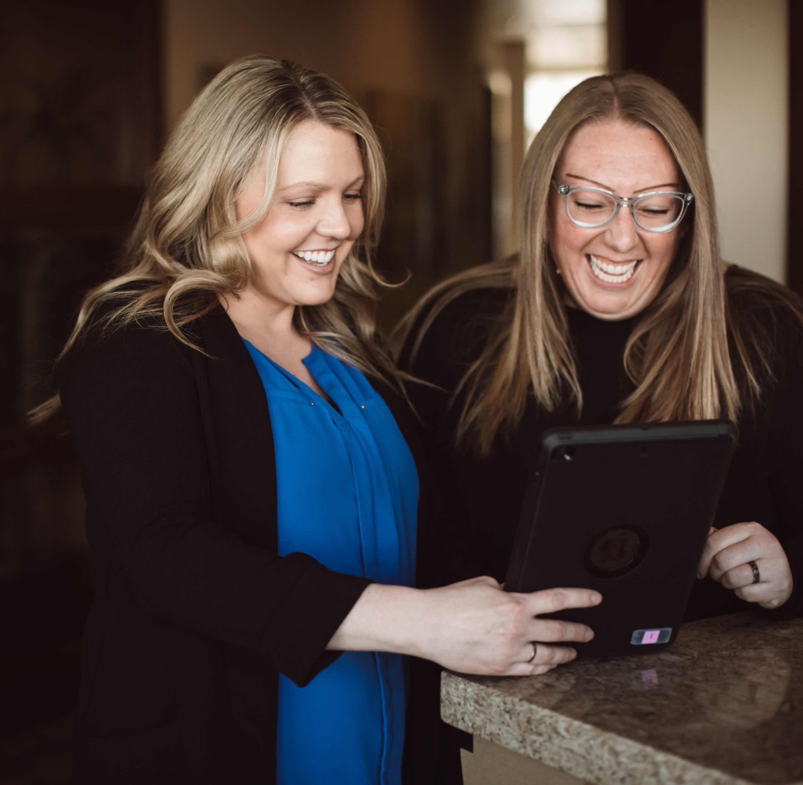 Photo of a team member and a patient looking at a tablet