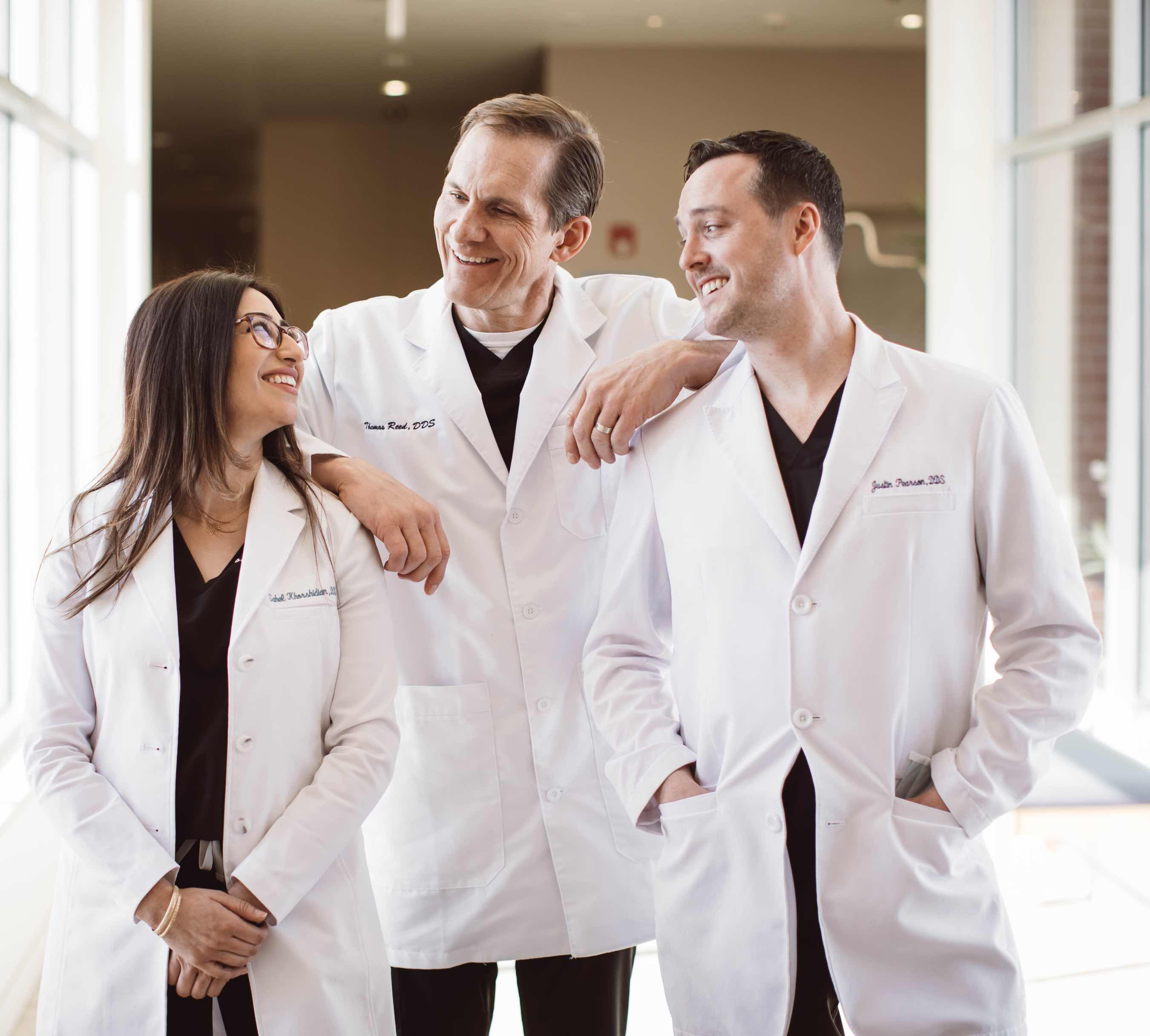 Photo of Englewood dentists Dr. Sahel Khorshidian, Dr. Thomas Reed, and Dr. Justin Pearson