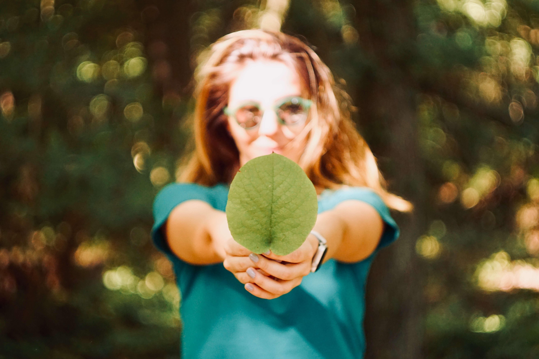 Woman holding a leaf
