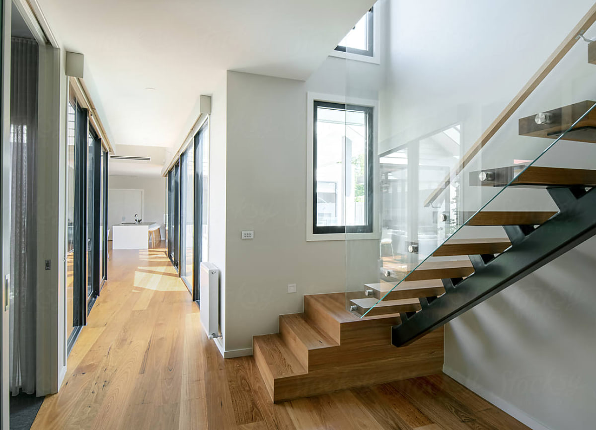 Modern stairway with wood floor, white walls and windows