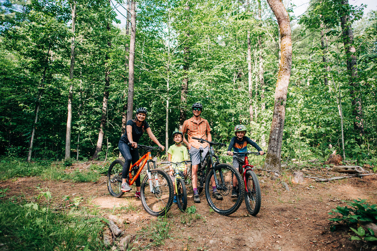 Tyler Ray and family riding gravel roads at Cranmore Mountain.