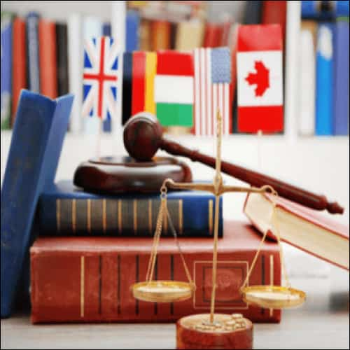 Books, scales, gavel and flags from different countries
