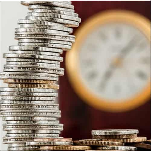 Coins with clock in background