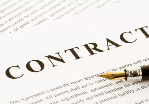 Image of a business contract with a pen