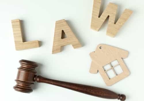 Image of wooden letters that spell law and an image of a wooden house