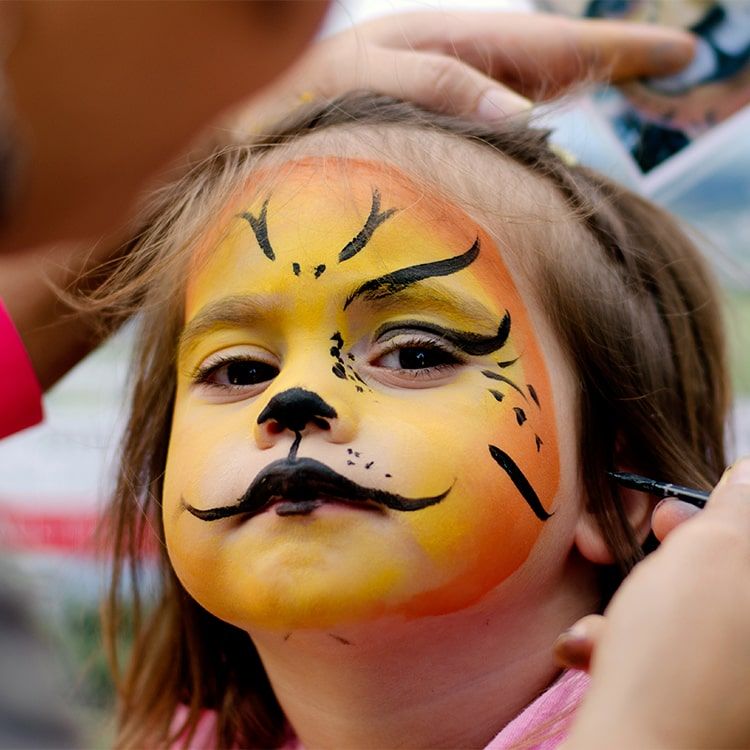 Kid getting her face painted