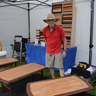 Artist with woodworking on display