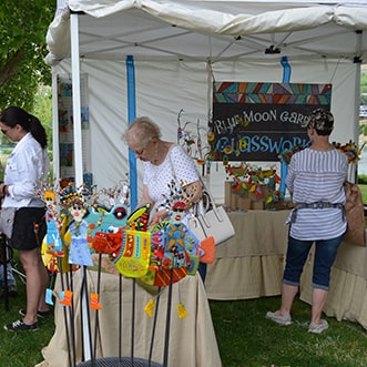 People visiting an artist booth