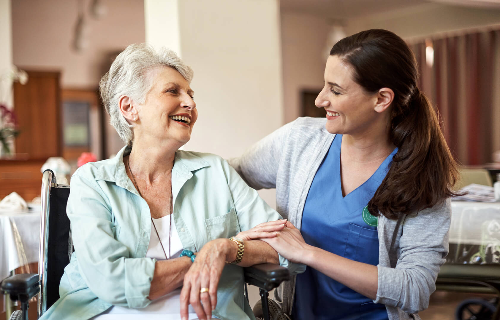 Abberfield  Aged Care  nurse laughing with Elderly Lady