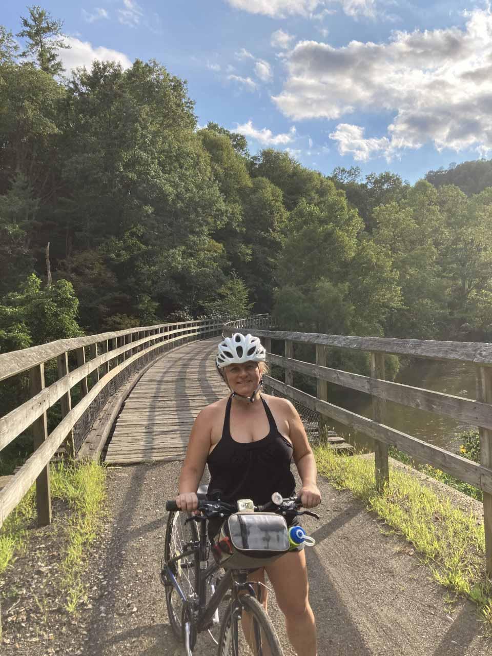 Woman riding bike on NRV trail