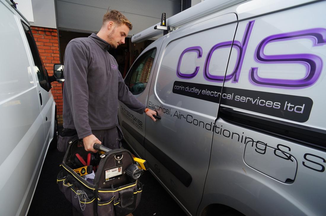 CDS employee loading sign written van ready for a days work