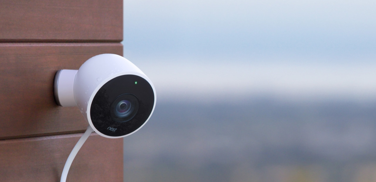 A Nest security camera mounted on a wall