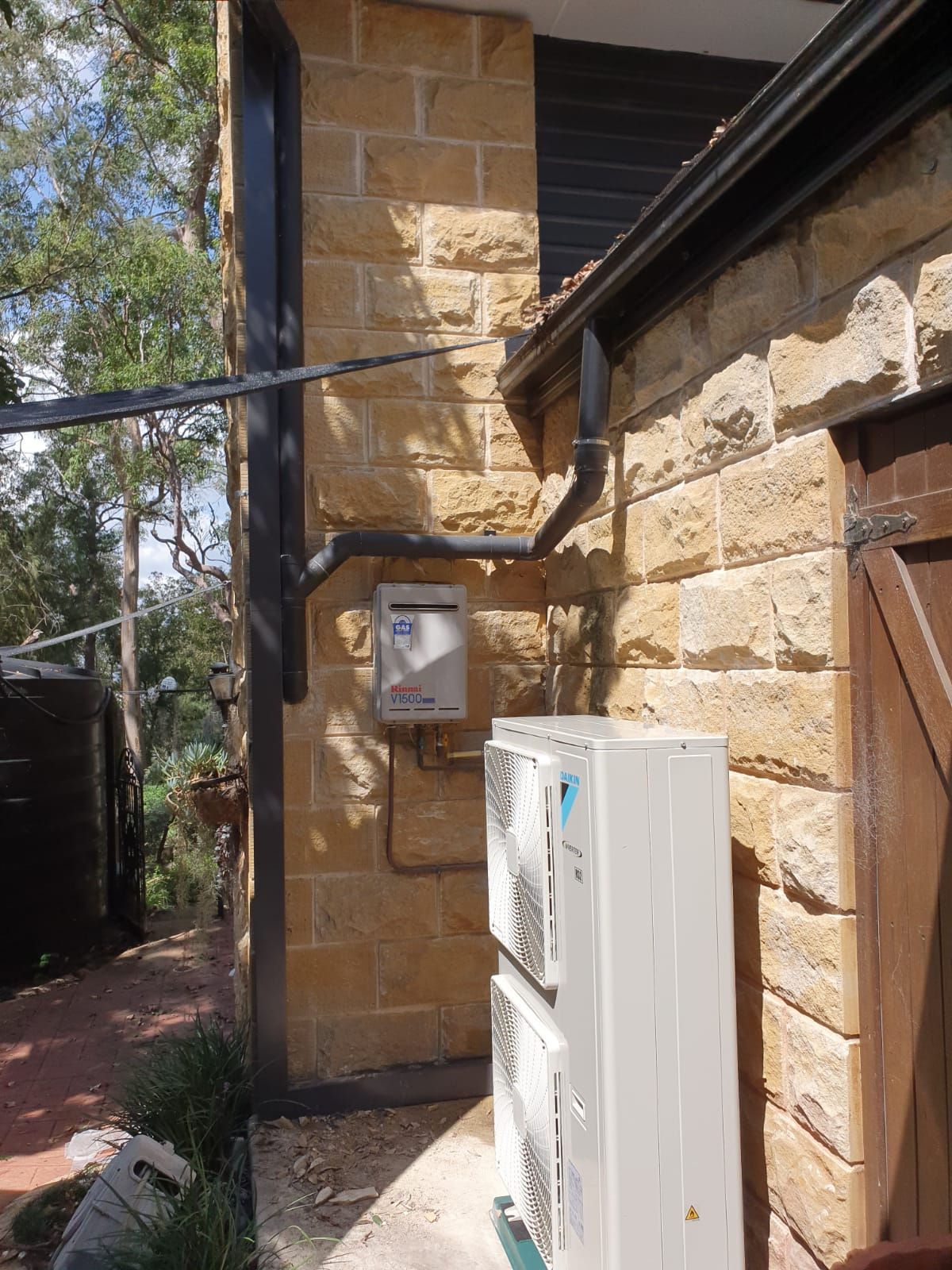 A residential air conditioning system outside a home