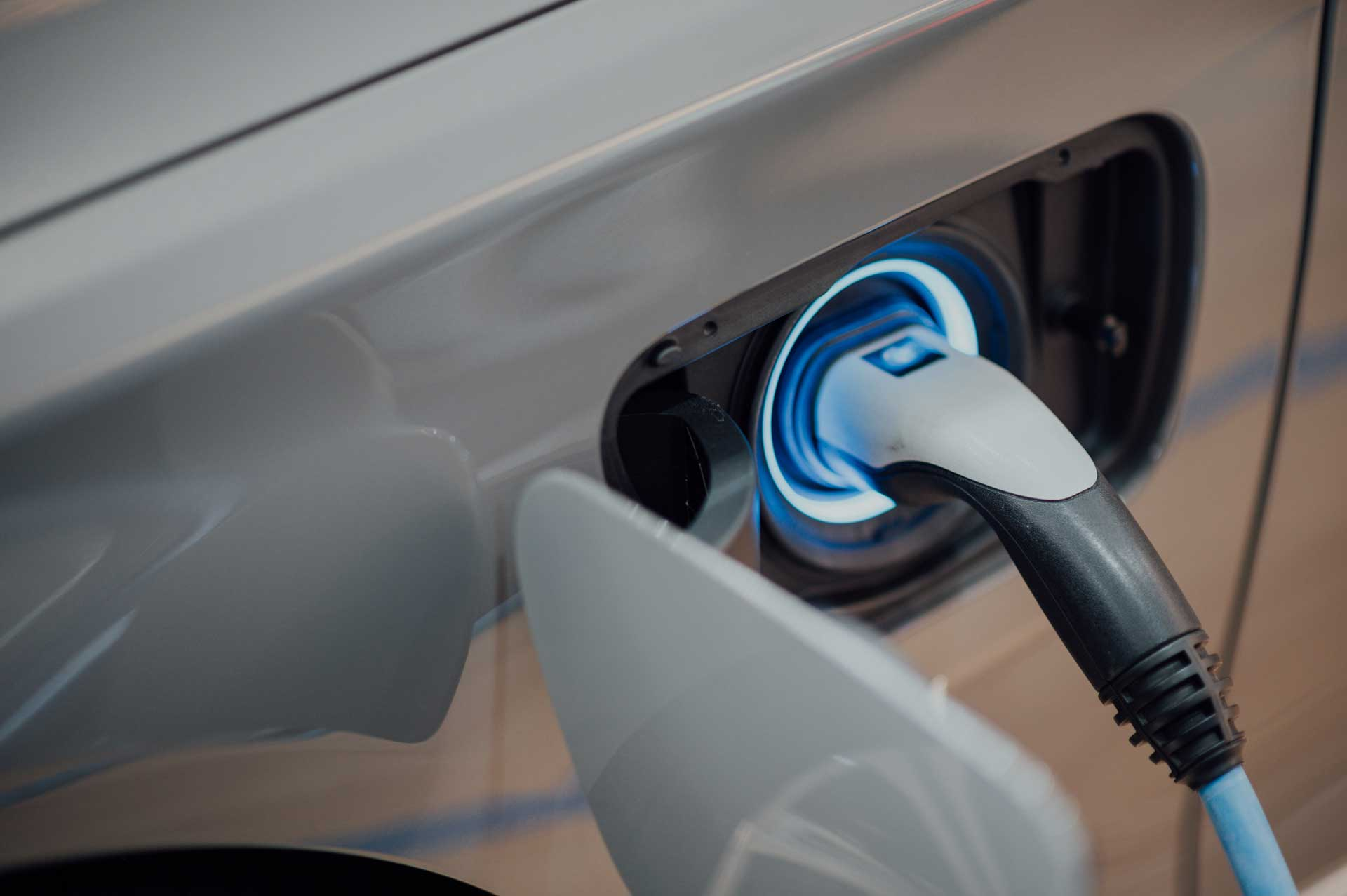 An electric car being charged by an electric power point