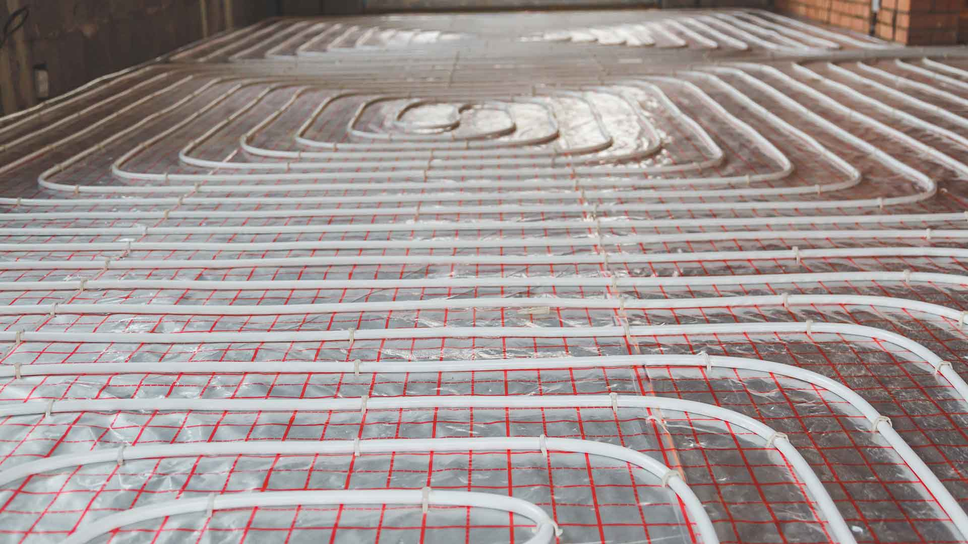 A run of underfloor heating cables ready to be laid over
