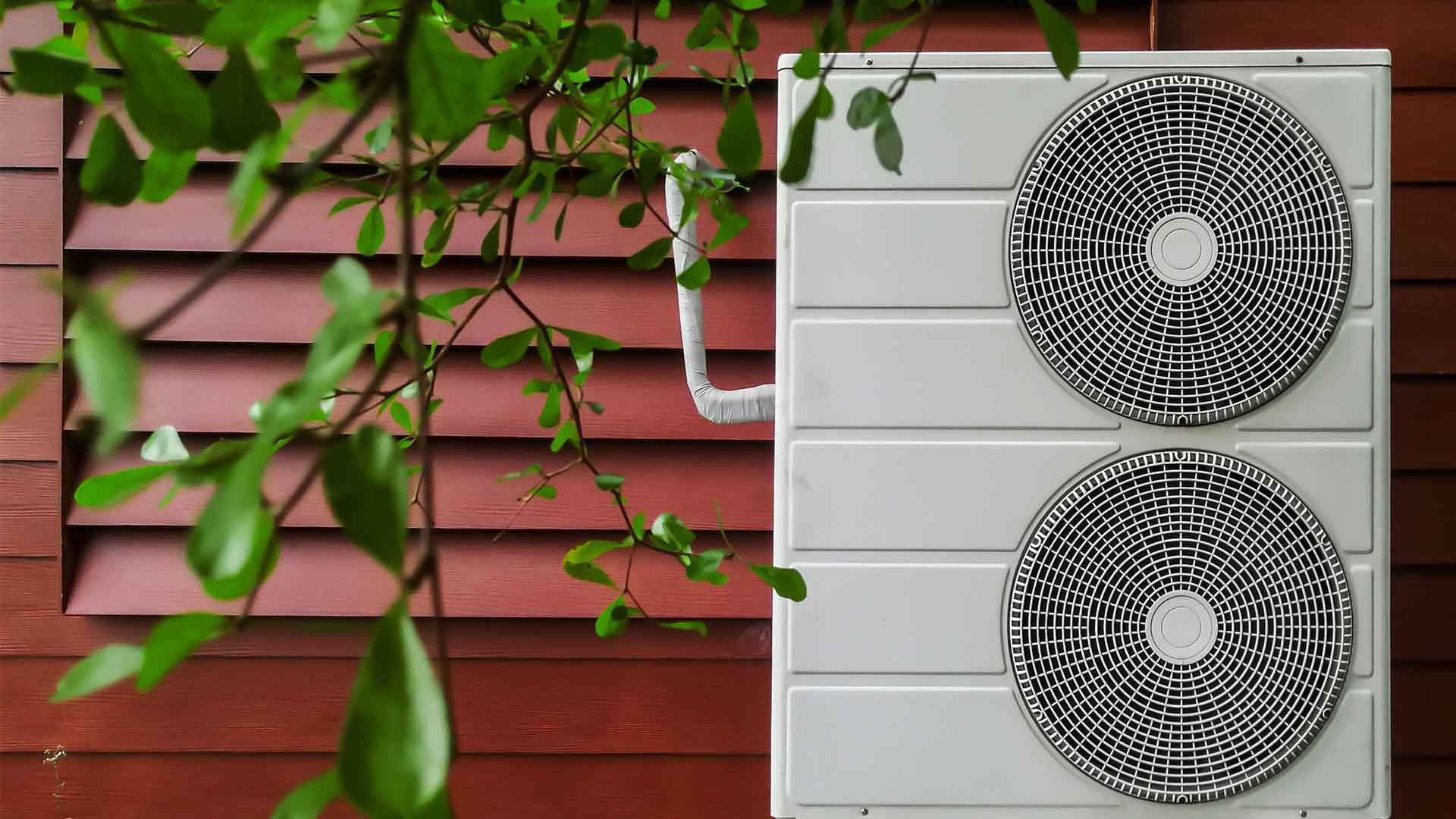 Air conditioning units on wall, outside a house, mounted on the ground