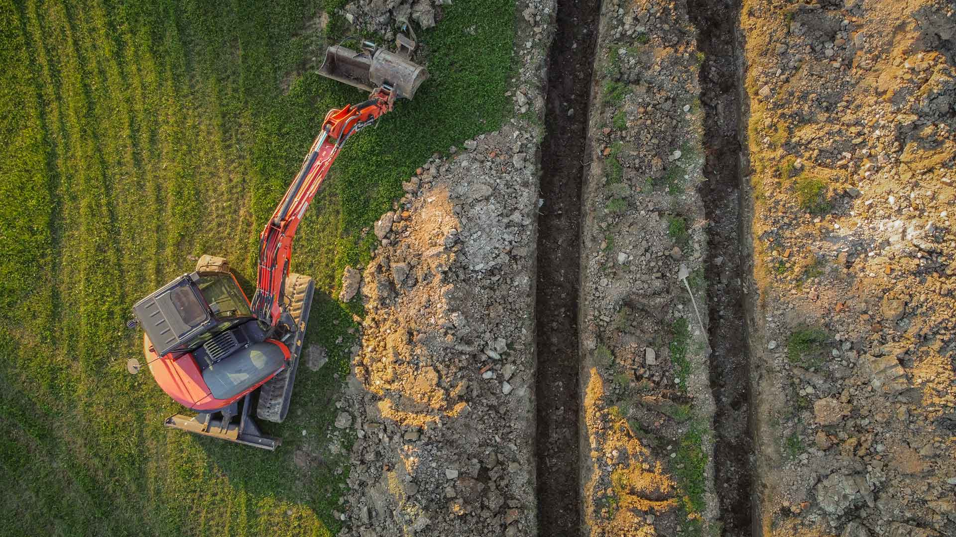 Large digger removing earth from site