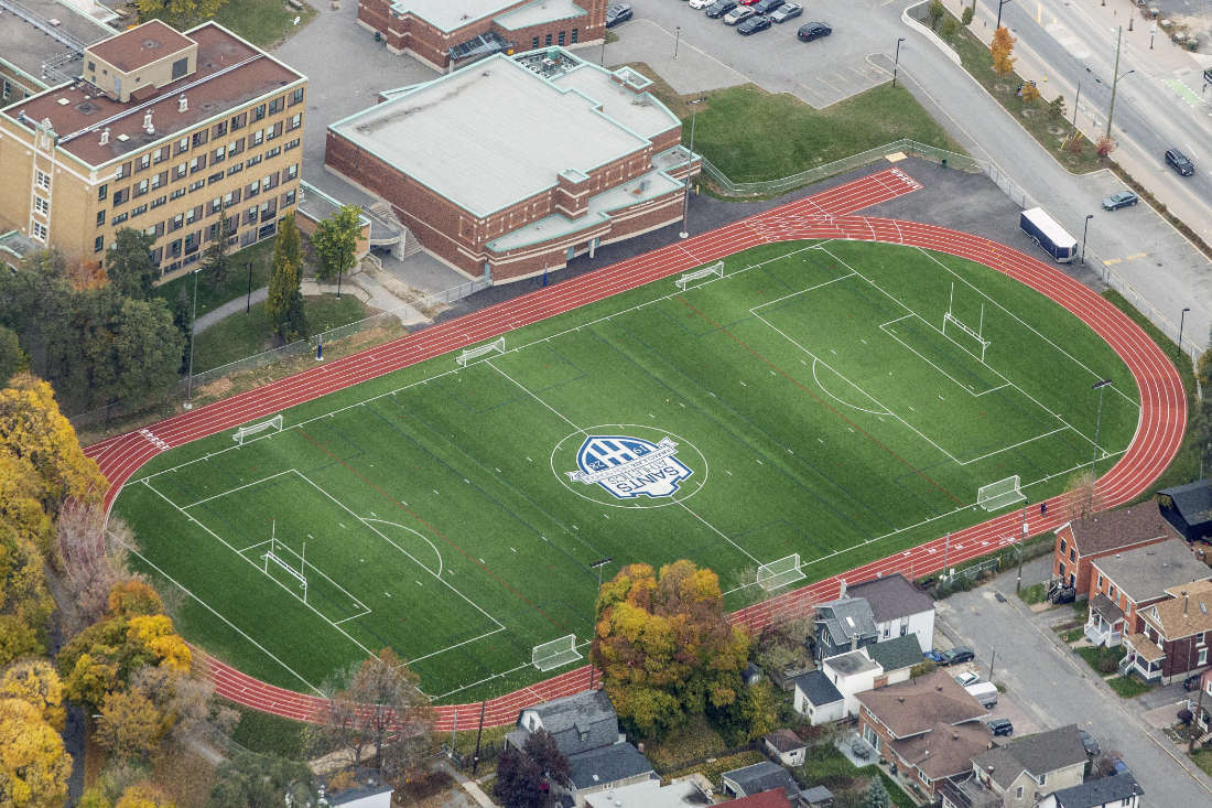 aerial view of sports field inside rubber running track at Immaculate High School in Ottawa